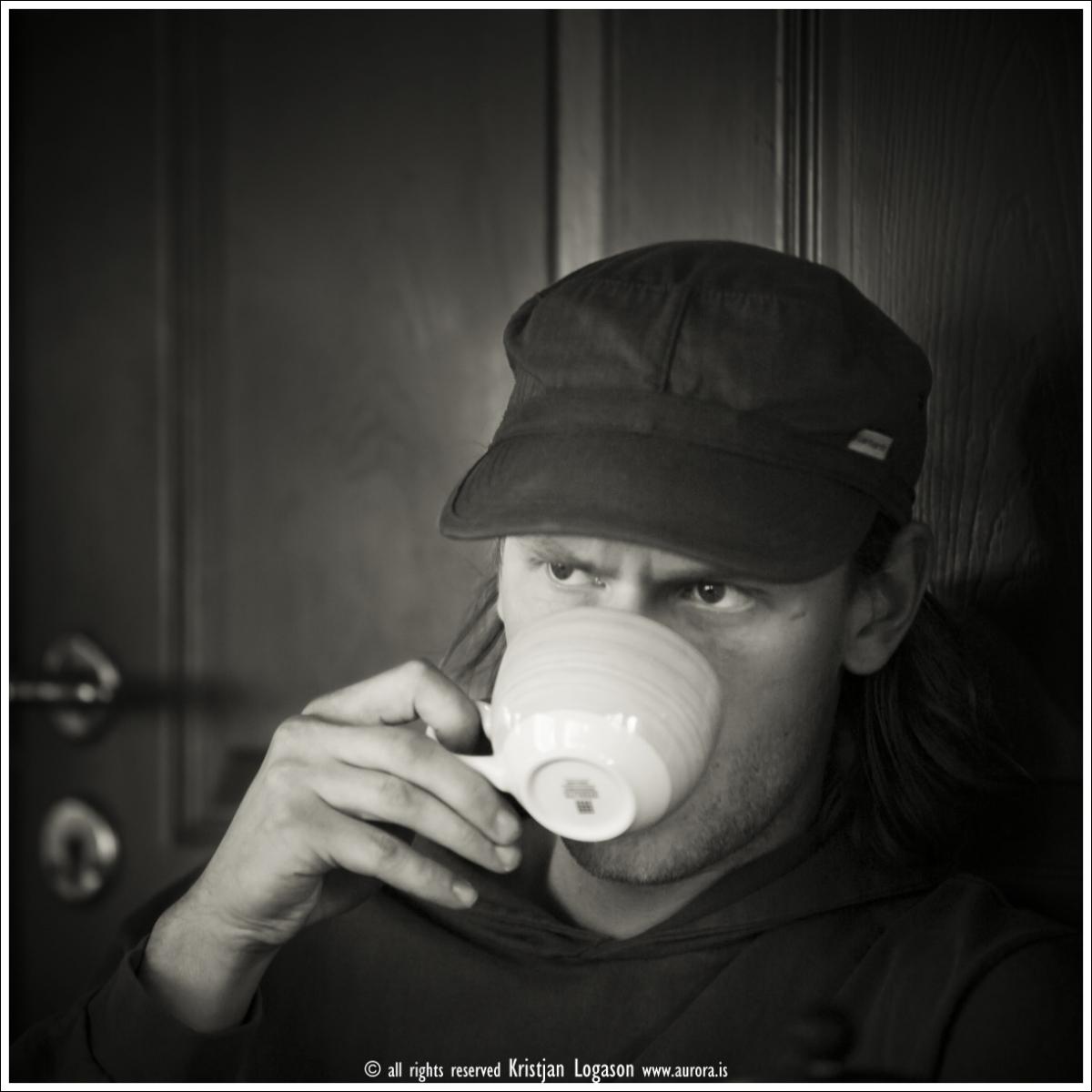 Man drinking coffee at Prikið cafe in Reykjvik Iceland