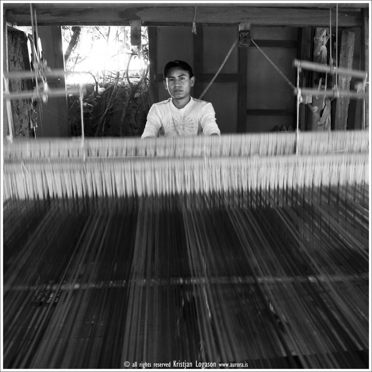 Man Weaving fabric in Ataco on Ruta de flores in the Sonsonate district of El Salvador