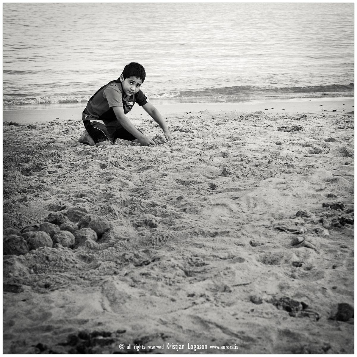 Boy building sand castle