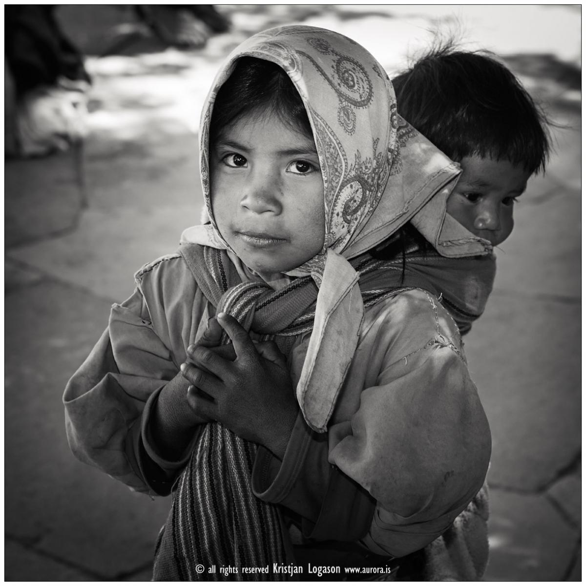 Young Tarahumara girl carrying here brother