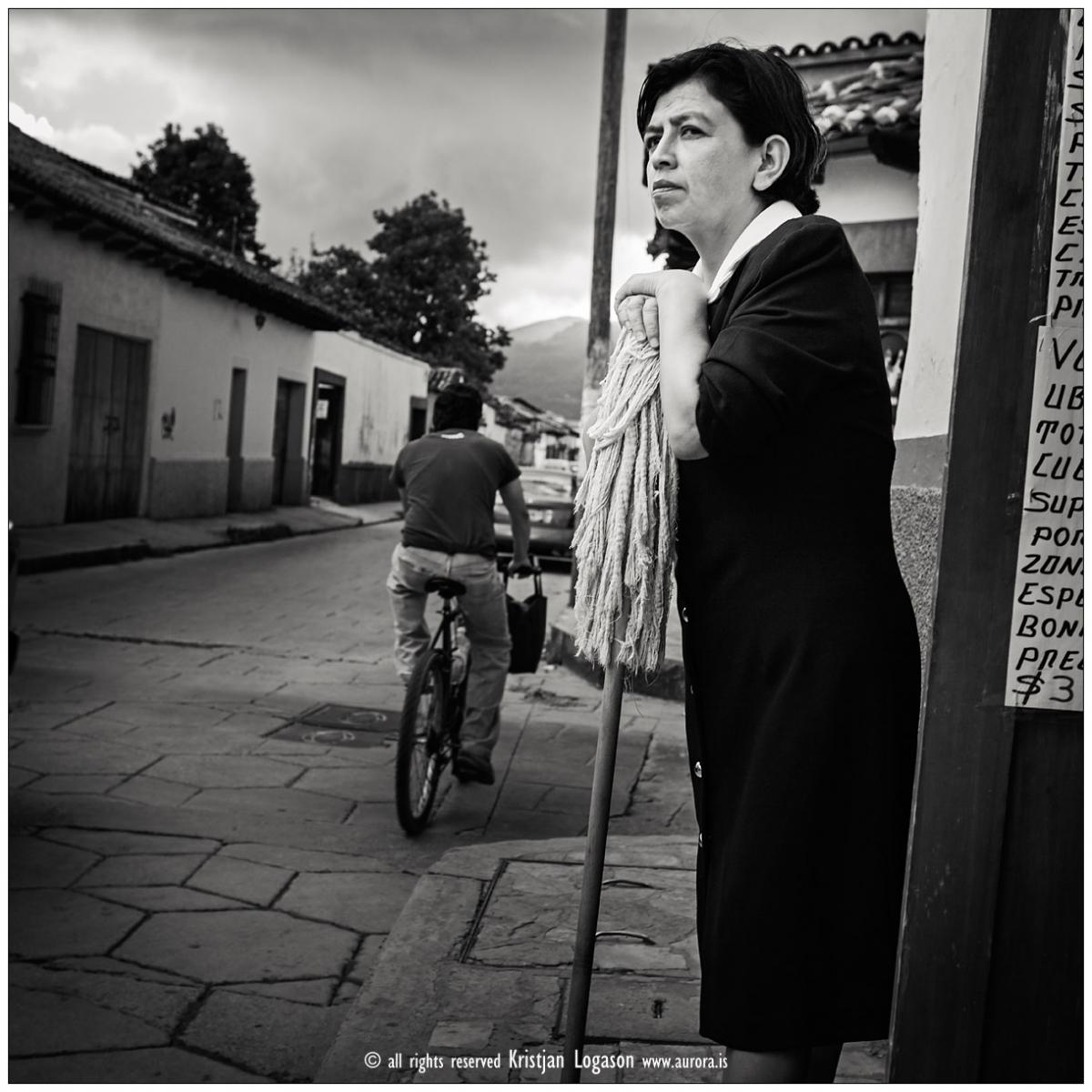 Woman with broom in the street of San Cristobal las Casas