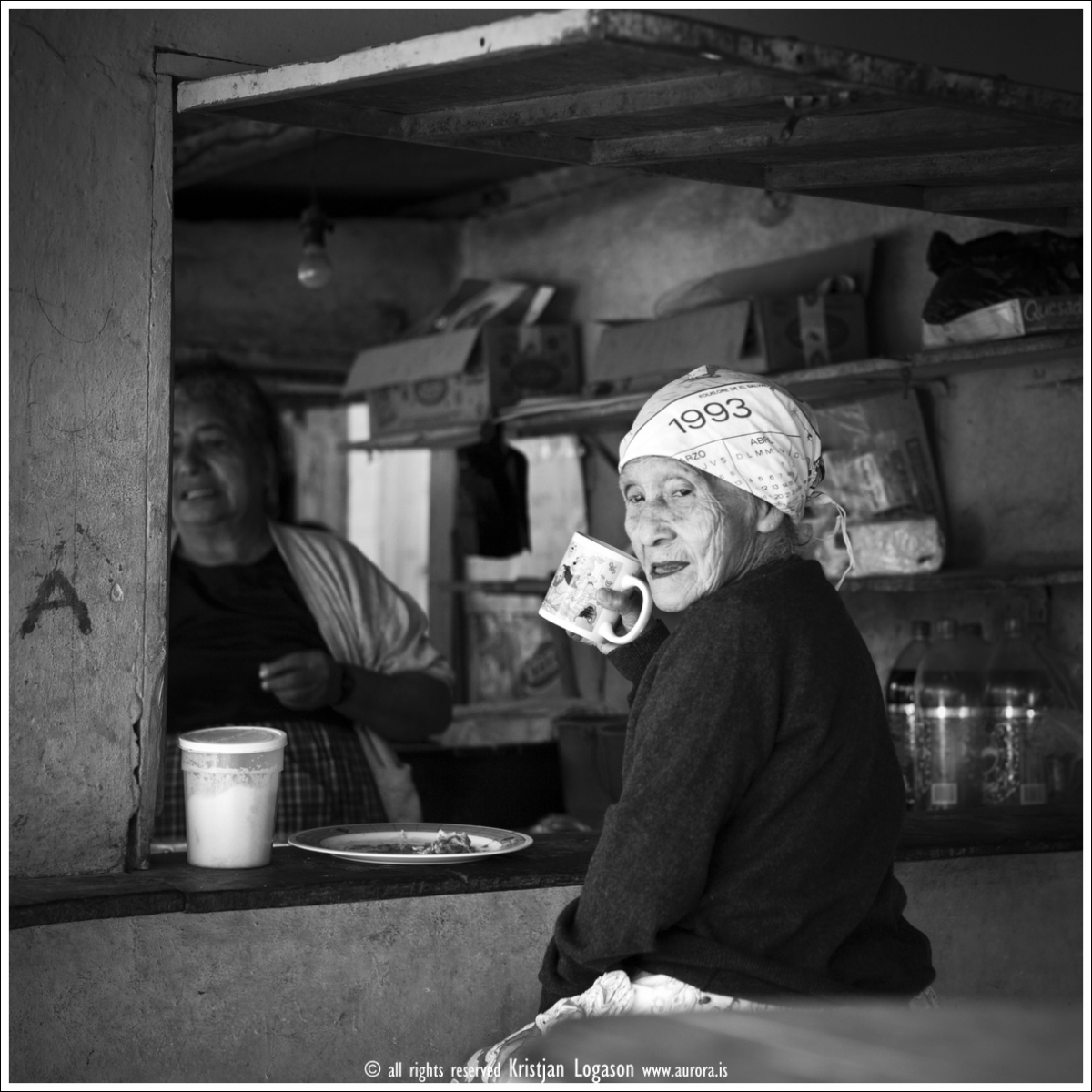 Old woman at the market in Concepcion de Ataco having here breakfast and coffee