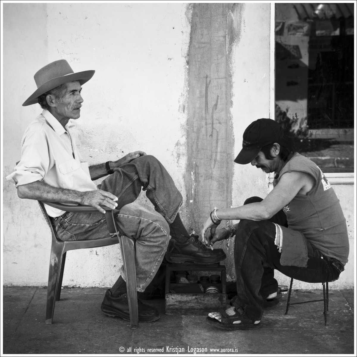 Elderly man in Suchitoto, El salvador, getting a shoe shine