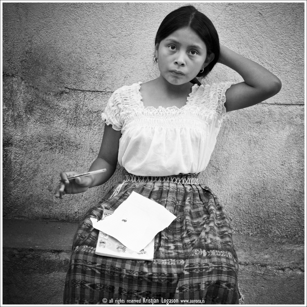 Guatemalan Girl doing homework out in the street of San Pedro
