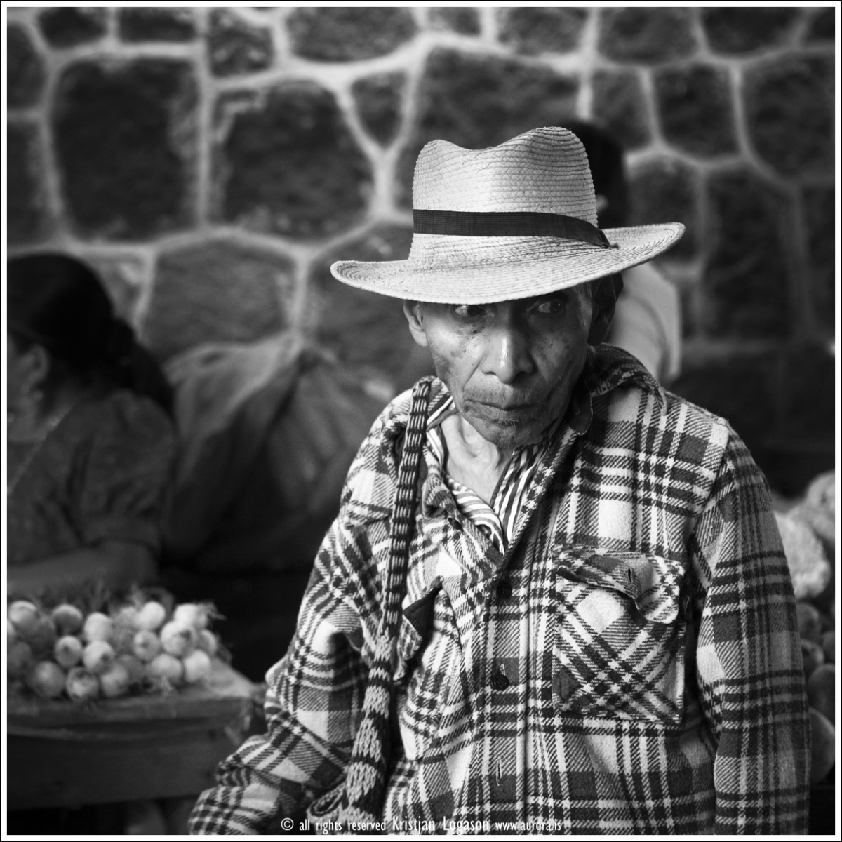 Man with hat shopping at the market in San Pedro