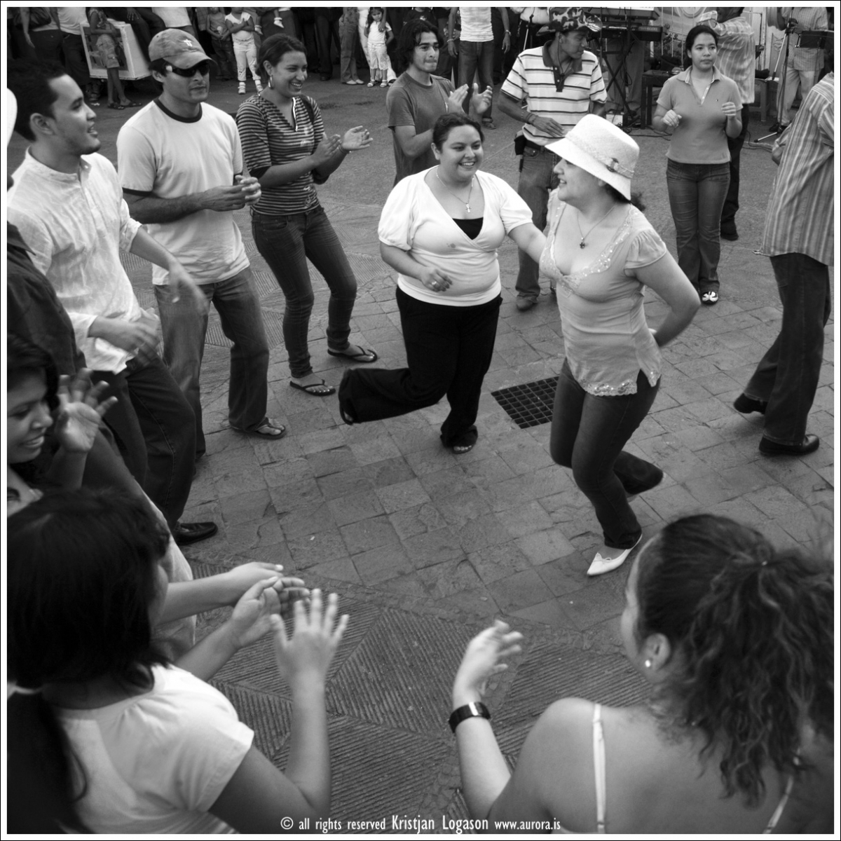 People gathered for fun at sunday dancing on the main square in Grenada, Nicaragua