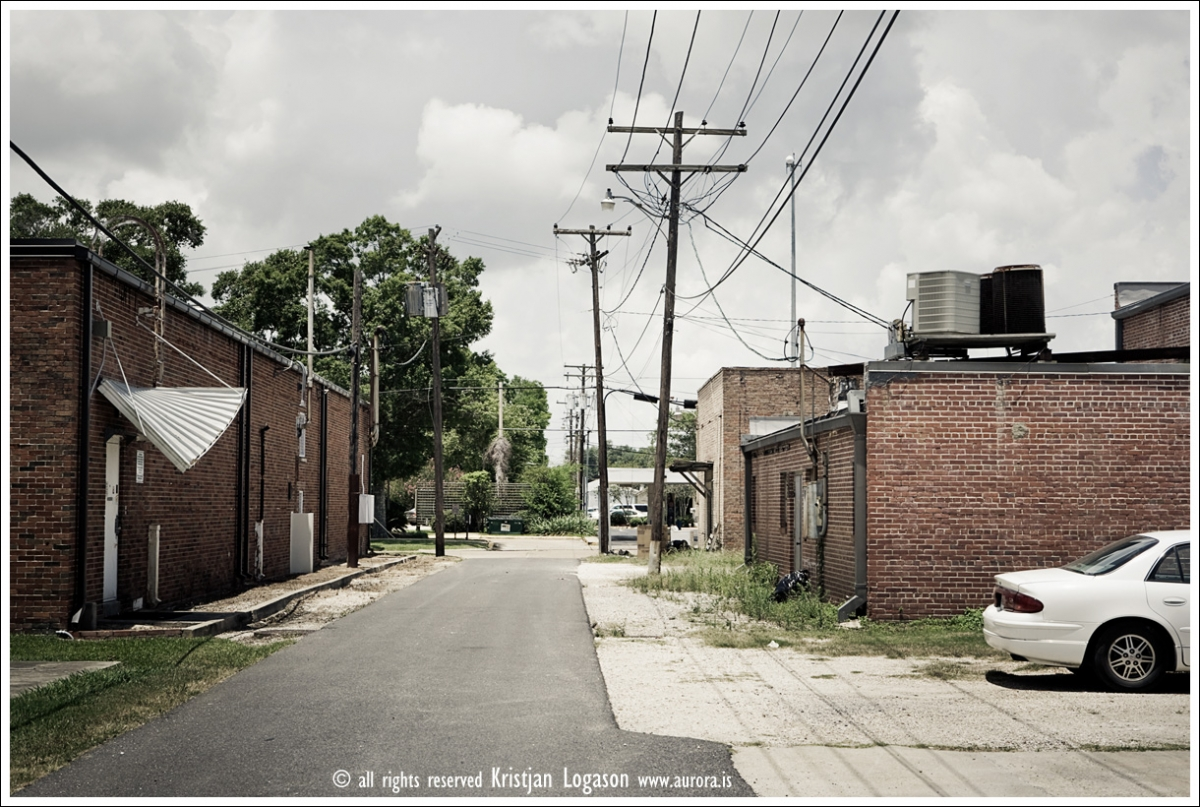 gray car and back alley