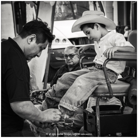 Young ranchero having a shoe shine