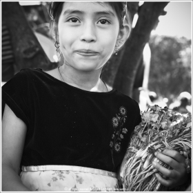 Young girl selling spice at the fiesta gastronomica in Juayua, El Salvador