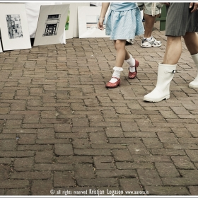 White boots red shoes and photographs